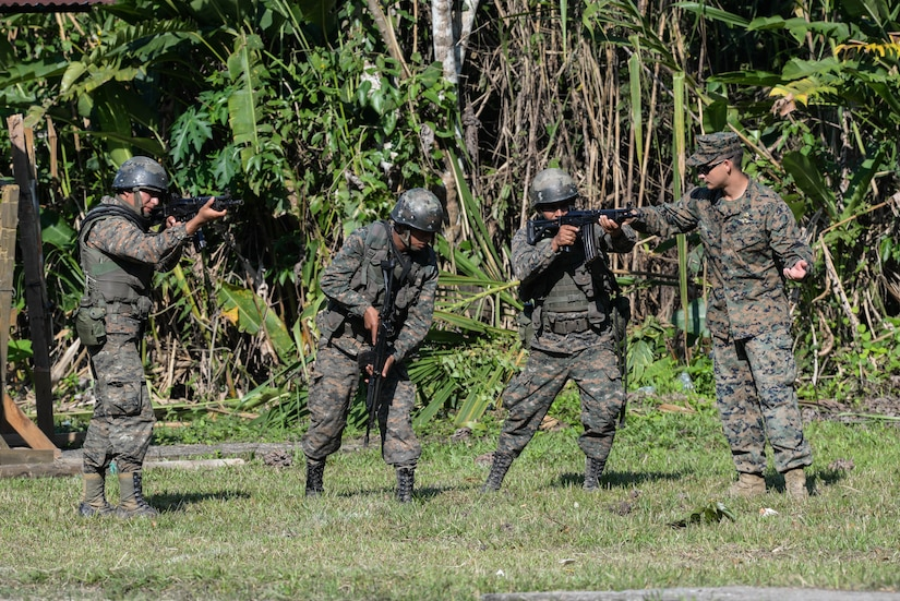 Subject matter experts from a U.S. Marine Security Cooperation Team provide proper firing and safety techniques March 10, 2016, Guatemala, during a live-fire exercise. The exercise was part of a final evaluation in a four-week course requested by the Guatemalans, providing training and real-life simulations to help the Guatemalans conduct counter-drug operations. (U.S. Air Force photo by Staff Sgt. Westin Warburton/NOT RELEASED)
