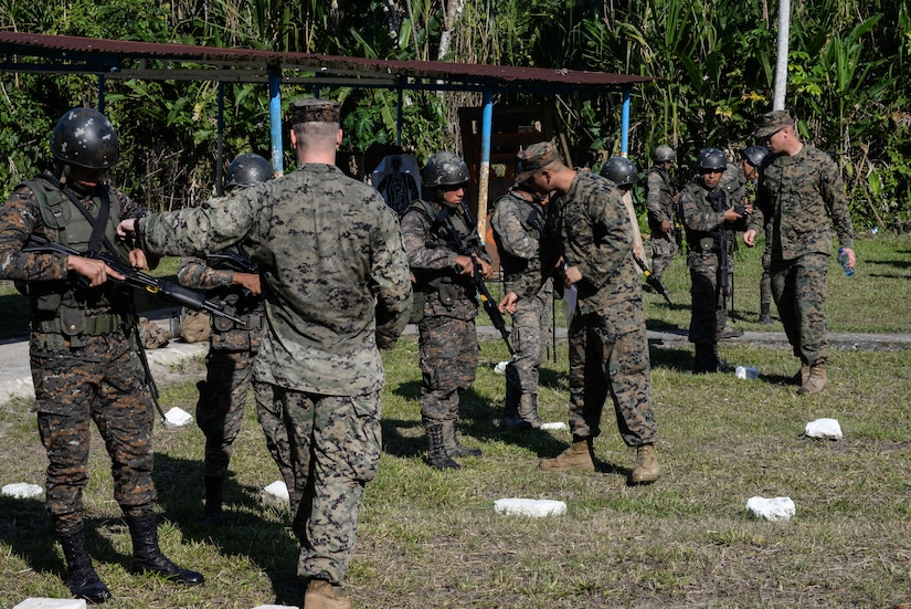 Trainers from a U.S. Marine Security Cooperation Team provide proper firing and safety techniques March 10, 2016, Guatemala, during a live-fire exercise. The exercise was part of a final evaluation in a four-week course requested by the Guatemalans, providing training and real-life simulations to help the Guatemalans conduct counter-drug operations. (U.S. Air Force photo by Staff Sgt. Westin Warburton/RELEASED)