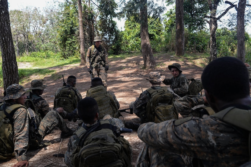 Guatemalan marines conduct a brief March 9, 2016, Guatemala, as part of an exercise which tested their ability to navigate to an objective and operate in an urban environment. The exercise was a final evaluation in course requested by the Guatemalans to provide training and real-life simulations for the Guatemalans marines. (U.S. Air Force photo by Staff Sgt. Westin Warburton/RELEASED)