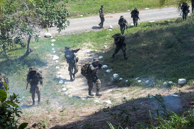 Guatemalan marines undergo a simulated ambushed during a training exercise March 9, 2016, Guatemala, testing their ability to respond to various scenarios when conducting counter drug operations. The Guatemalan marines partnered with U.S. Marine trainers to learn basic infantry movements and squad-level team work, completing a four week training course with a final exercise. (U.S. Air Force photo by Staff Sgt. Westin Warburton/RELEASED)