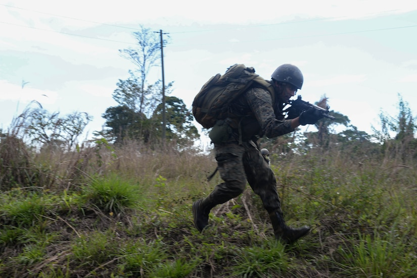 A Guatemalan marine runs March 9, 2016, Guatemala during a final squad-level training exercise. The Guatemalan marines participated in various exercises before graduating a four-week training course their U.S. Marine partners instructed to help evaluate best practices for small team movement and engagement. (U.S. Air Force photo by Staff Sgt. Westin Warburton/RELEASED)