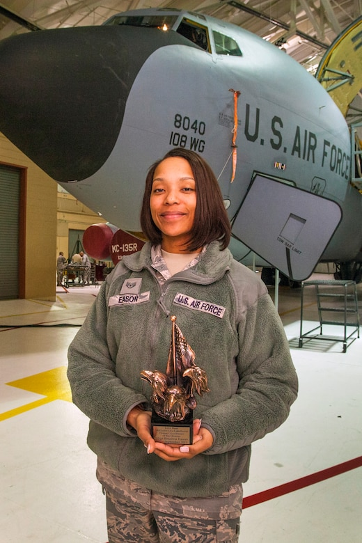 Staff Sgt. Brianna M. Eason, an orderly room clerk with the 108th Wing Maintenance Operations Flight, New Jersey Air National Guard, poses with Joint Base McGuire-Dix-Lakehurst Honor Guardsman of the Quarter, July – September 2015 trophy in front of a 108th Wing KC-135R Stratotanker at Joint Base McGuire-Dix-Lakehurst, N.J., March 14, 2016. Eason was chosen as the 87th Air Base Wing Honor Guard Member of the Year for January 2015 to December 2015. Eason serves as the Non-Commissioned Officer in Charge of training for the 87th ABW Honor Guard. (U.S. Air National Guard photo by Master Sgt. Mark C. Olsen/Released)