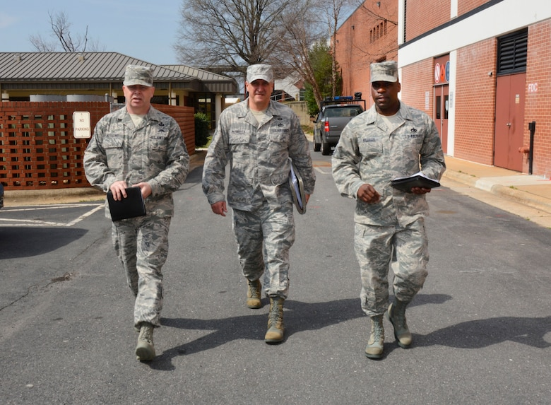 U.S. Air Force Chief Master Sgt. James W. Hotaling (left), command chief master sergeant of the Air National Guard, Chief Master Sgt. Salvatore Pecorella (center), command chief for the 145th Airlift Wing, and Chief Master Sgt. Maurice Williams (right), state command chief for the N.C. Air National Guard, walk about the N.C. Air National Guard Base, at Charlotte Douglas International Airport, March 12, 2016, following several motivating and inspirational leadership meetings with various Airmen.  (U.S. Air National Guard photo by Master Sgt. Rich Kerner/Released)