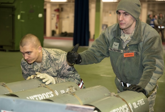 U.S. Air Force Airman 1st Class Jordan Herring, a 35th Medical Support Squadron logistician, left, and Airman 1st Class Truskowski, 35th Logistics Readiness Squadron vehicle and equipment mechanic apprentice, right, move cargo onto a scale at Misawa Air Base, Japan, March 15, 2016. Cargo is weighed to ensure proper balance on transport aircraft. (U.S. Air Force photo by Airman 1st Class Jordyn Fetter)