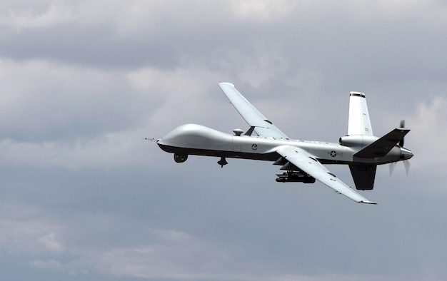 An MQ- Reaper remotely piloted aircraft performs aerial maneuvers over Creech Air Force Base, Nev., June 25, 2015. The MQ-9 Reaper is an armed, multi-mission, medium-altitude, long-endurance remotely piloted aircraft that is employed primarily as an intelligence-collection asset and secondarily against dynamic execution targets. (U.S. Air Force photo by Senior Airman Cory D. Payne/Not Reviewed)