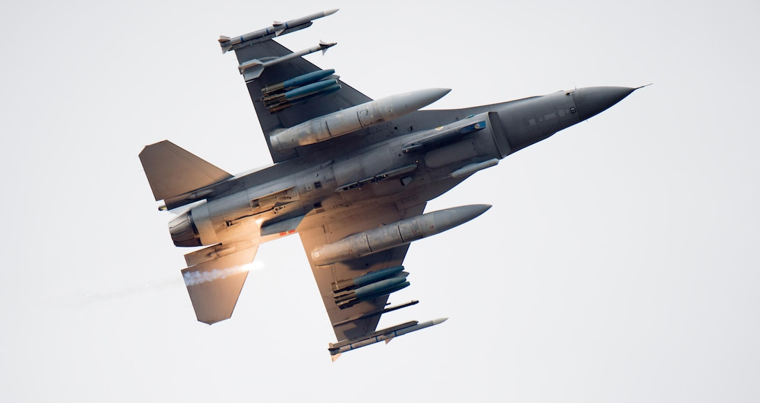 An F-16 Fighting Falcon releases a flare over Grand Bay Bombing and Gunnery Range at Moody Air Force Base, Ga., March 4, 2016. Multiple aircraft within Air Combat Command conducted joint aerial training that showcased tactical air and ground maneuvers as well as weapons capabilities. (U.S. Air Force photo/Staff Sgt. Brian J. Valencia)