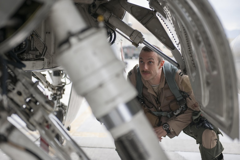 Capt. Tim Six, a 421st Expeditionary Fighter Squadron pilot, performs preflight checks on an F-16 Fighting Falcon at Bagram Airfield, Afghanistan, March 14, 2016. The 421st EFS, based out of Bagram Airfield, is the only dedicated fighter squadron in the country and continuously supports Operation Freedom's Sentinel and NATO's Resolute Support missions. (U.S. Air Force photo/Tech. Sgt. Robert Cloys)