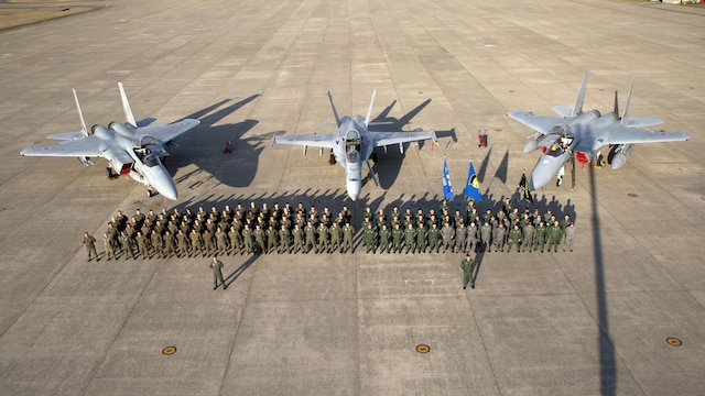 Members of Marine Fighter Attack Squadron 314 and Japan Air Self-Defense pose for a photo in front of an F/A-18A and two F-15s at Komatsu Air Base, Japan, during the Komatsu Aviation Training Relocation exercise March 17, 2016. VMFA-314, home based out of Marine Corps Air Station Miramar, San Diego, temporarily deployed to MCAS Iwakuni for a six month rotation with the unit deployment program, is forward deployed to Komatsu, Japan for the ATR.