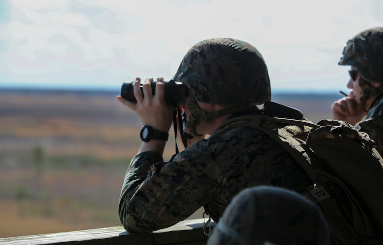 Capt. Justin L. Carter, a forward air controller with 2nd Battalion, 8th Marine Regiment, observes targets down range during a fire support coordination exercise at Camp Lejeune, N.C., March 15, 2016. The exercise was the first to allow the unit to collaborate with their 1st Battalion, 10th Marine Regiment attachment that will be among them during their upcoming deployment. (U.S. Marine Corps photo by Cpl. Paul S. Martinez/Released)