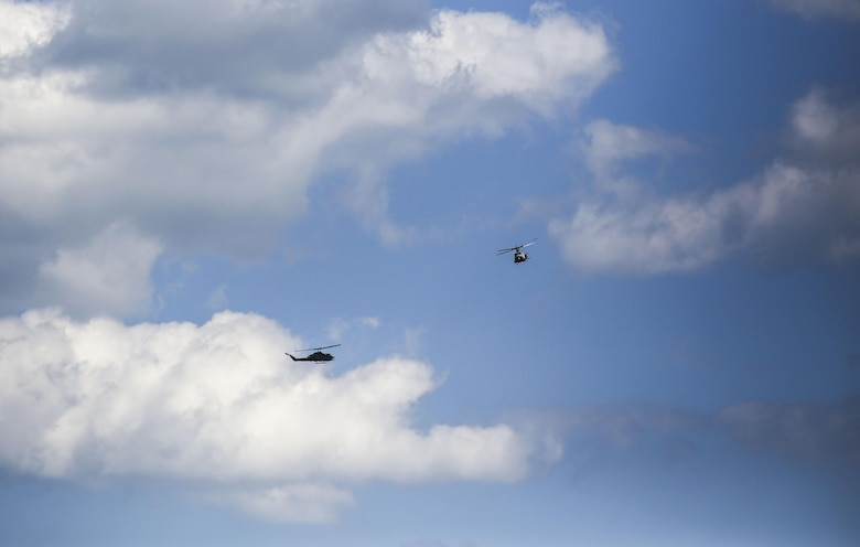 Rotary-wing aircraft operated by Marines with Marine Light Attack Helicopter Squadron 269 circle the airspace above Observation Post 3 during a battalion field exercise held by 2nd Battalion, 8th Marine Regiment at Camp Lejeune, N.C., March 15, 2016. The battalion coordinated with artillery, mortars and rotary-wing aircraft to direct fire support. (U.S. Marine Corps photo by Cpl. Paul S. Martinez/Released)