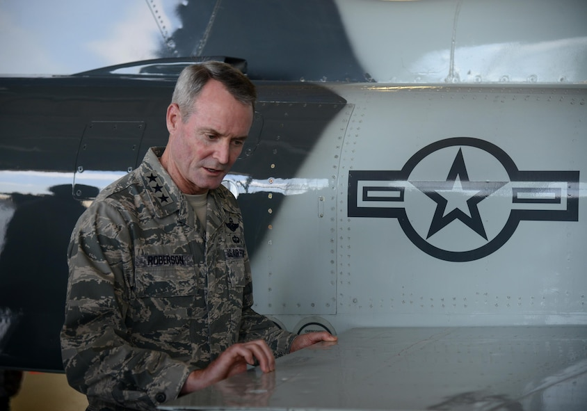 Lt. Gen. Darryl Roberson, commander of Air Education and Training Command, examines the wing of a hail-damaged T-38 Talon at Laughlin Air Force Base, Texas, March 16, 2016, during a base tour. While touring Laughlin, Roberson held an all-call, visited various base agencies and discussed operations with wing leaders. (U.S. Air Force photo by Airman 1st Class Brandon May)