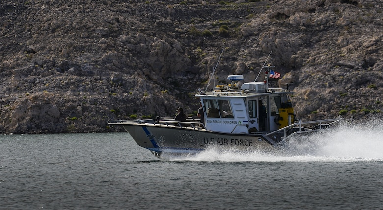 A Nellis Air Force Base, Nevada, 58th Rescue Squadron boat speeds across the water during a training exercise at Lake Mead, March 15, 2016. The boat picked up Pararescuemen after preforming static line jumps out of a C-130. Pararescue teams assault, secure, and dominate the rescue objective area utilizing any available DOD or Allied, air, land, or sea asset. (U.S. Air Force photo by Airman 1st Class Kevin Tanenbaum)
