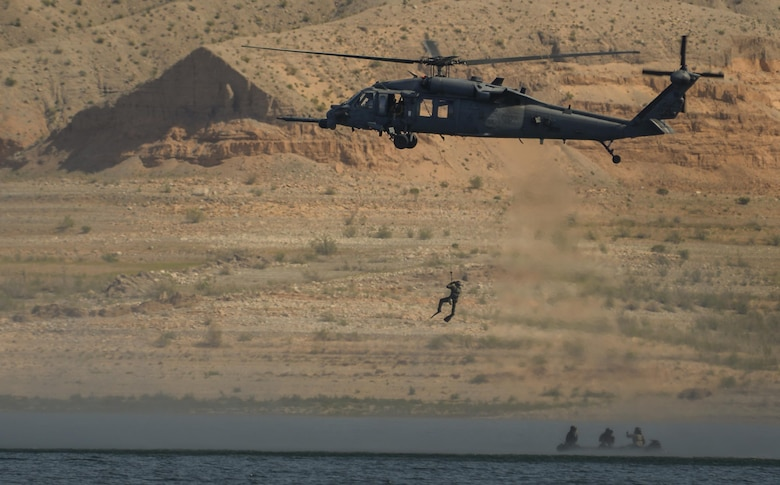 An HH-60G Pave Hawk, assigned to the 58th Rescue Squadron from Nellis Air Force Base, Nevada, preforms water operations training at Lake Mead, March 15, 2016. Pararescuemen receive comprehensive initial training and spend their careers continuously developing their proficiency in all phases of their career-field's capabilities. (U.S. Air Force photo by Airman 1st Class Kevin Tanenbaum)