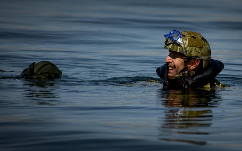 A Pararescuemen, assigned to the 58th Rescue Squadron at Nellis Air Force Base, Nevada waits to be picked up by a rescue boat after preforming a static line jump out of a C-130 over Lake Mead, March 15, 2016. Pararescue is the only United States Department of Defense elite combat force specifically organized, trained, equipped, and postured to conduct full spectrum personnel recovery to include both conventional and unconventional combat rescue operations. (U.S. Air Force photo by Airman 1st Class Kevin Tanenbaum)