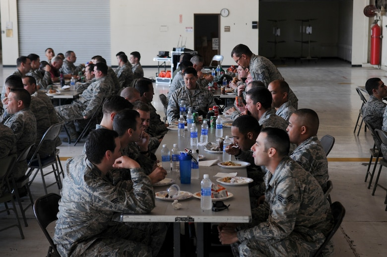 Beale Airmen talk during the inaugural Airman 2 Airman Prayer Lunch on Beale Air Force Base, California, Mar. 17, 2016. Airmen were invited to have lunch and open prayer by the Beale Chaplain Corps Team. (U.S. Air Force photo by Senior Airman Michael Hunsaker)