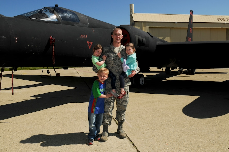 """Chaplain (Capt.) R. Brenner Campbell, 9th Reconnaissance Wing chaplain, poses with his children in front of a U-2 Dragon Lady on Beale Air Force Base, California, Mar. 17, 2016. """"Airman 2 Airman"""" fostered an inclusive environment encouraging personnel to be in touch with their spiritual side. (U.S. Air Force photo by Senior Airman Michael Hunsaker)"""