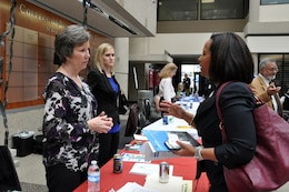 Valerie Carlton (Left), U.S. Army Corps of Engineers Nashville District Contracting chief, provides information to Patricia Bonilla, president and CEO of Lunacon Construction Group, during the Small Business Forum March 17, 2016 at Tennessee State University. The forum focused on women-owned small businesses.  About 360 small businesses were represented at the event sponsored by the U.S. Army Corps of Engineers Nashville District, Tennessee Small Business Development Center, and University of Tennessee Center for Industrial Services Procurement Technical Assistance Center.