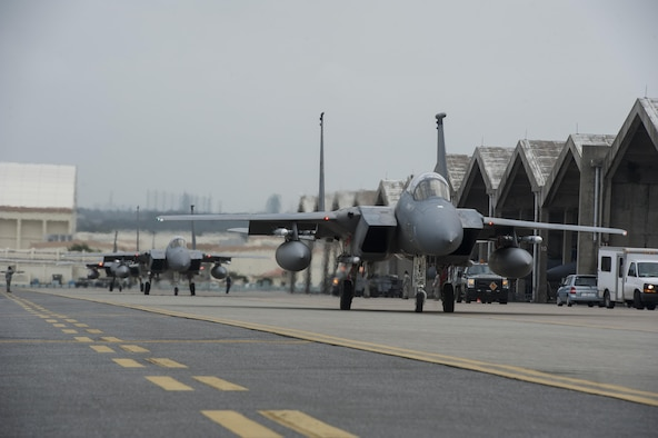 F-15 Eagles from Kadena's 44th Fighter Squadron taxi down the runway March 18, 2016, at Kadena Air Base, Japan. Members of the 44th FS participated in training to demonstrate Kadena's air superiority and wartime readiness. (U.S. Air Force photo by Airman 1st Class Lynette M. Rolen)