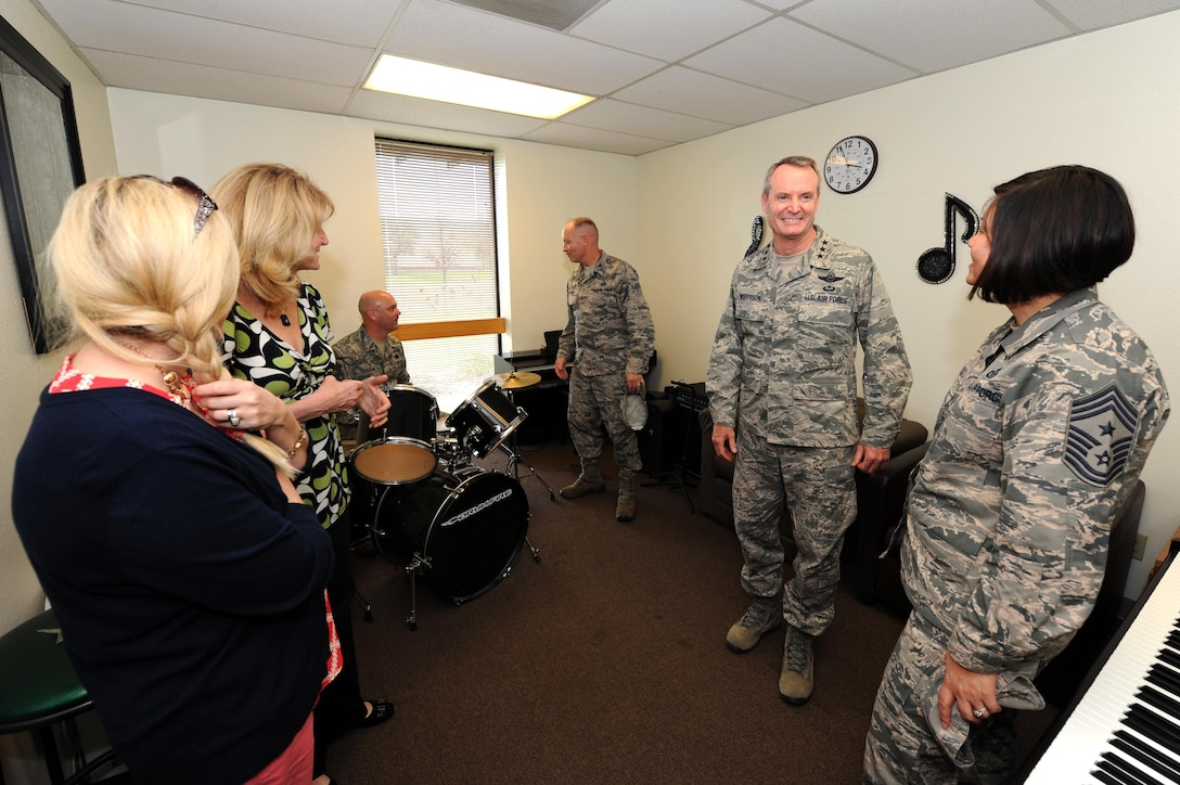 """U.S. Air Force Lt. Gen. Darryl L. Roberson, commander of Air Education and Training Command(second from right), tours the Crossroads Student Ministry Center with Chief Master Sgt. JoAnne S. Bass, 17th TRW command chief (right), Cheryl Roberson (second from left), and Kristen Staton (left), at Goodfellow Air Force Base, Texas, March 17, 2016. The Crossroads, nicknamed a """"Home Away From Home,"""" is unique to Goodfellow, offering students a place to decompress. (U.S. Air Force photo by Senior Airman Josh Edwards/Released)"""
