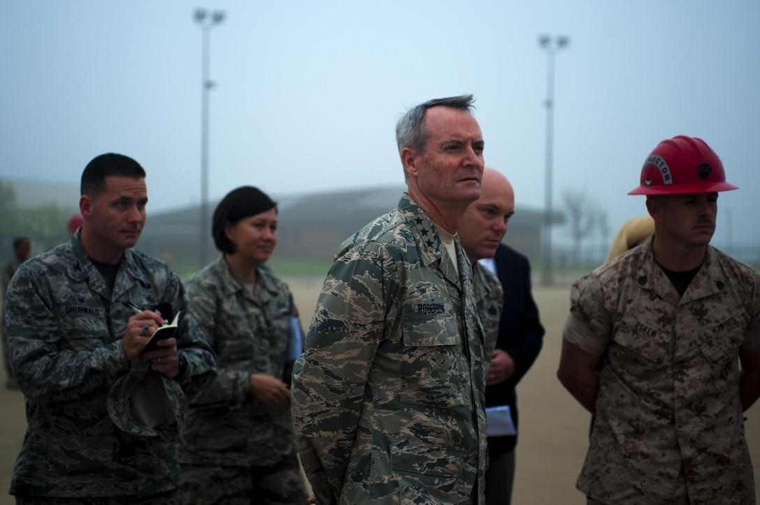 U.S. Air Force Lt. Gen. Darryl L. Roberson, commander of Air Education and Training Command, Chief Master Sgt. David R. Staton, AETC command chief, Col. Michael Grunwald, 17th Training Group commander, and Chief Master Sgt. JoAnne S. Bass, 17th Training Wing command chief, examine the C-135 fire training exercise while touring the Department of Defense Louis F. Garland Fire Academy at Goodfellow Air Force Base, Texas, March 18, 2016. Noise and smoke in the search and rescue trainer room is used to overstimulate the firefighters' senses. . (U.S. Air Force photo by Senior Airman Scott Jackson/Released)