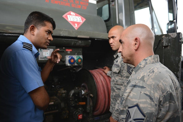 Squadron Leader Mohammad Ashraf, Bangladesh Air Force representative, left, discusses operational capabilities with fuels distribution experts during Pacific Agility 16-1, March 17, 2016, at Andersen Air Force Base, Guam. Pacific Agility is a Pacific Air Forces-led engagement focusing on a series of logistics subject-matter expert exchanges designed to increase partner capabilities, military relations and regional stability for the Indo-Asia-Pacific region. (U.S. Air Force photo by Airman 1st Class Arielle Vasquez/Released)