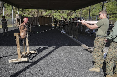 A Marine with Combat Logistics Battalion 2 shoots a dummy with the X26 TASER during a qualification and exposure course at Expeditionary Operations Training Group compound on Marine Corps Base Stone Bay, March 18, 2016.  Marines and sailors went through the course as pre-deployment training in preparation for the upcoming Special Purpose Marine Air-Ground Task Force-Crisis Response-Africa later this year. (U.S. Marine Corps photo taken by Cpl. Alexander Mitchell/released)