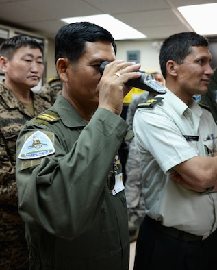 Lt. Col. Kong Rithy, Royal Cambodian Air Force weapons and aerodrome specialist, looks at a refractometer March 17, 2016, at Andersen Air Force Base, Guam. A refractometer is a tool used to determine percentages of fuel additives. Pacific Agility is a Pacific Air Forces-led engagement focusing on a series of logistics subject-matter expert exchanges designed to increase partner capabilities, military relations and regional stability for the Indo-Asia-Pacific region. (U.S. Air Force photo by Airman 1st Class Arielle Vasquez/Released)