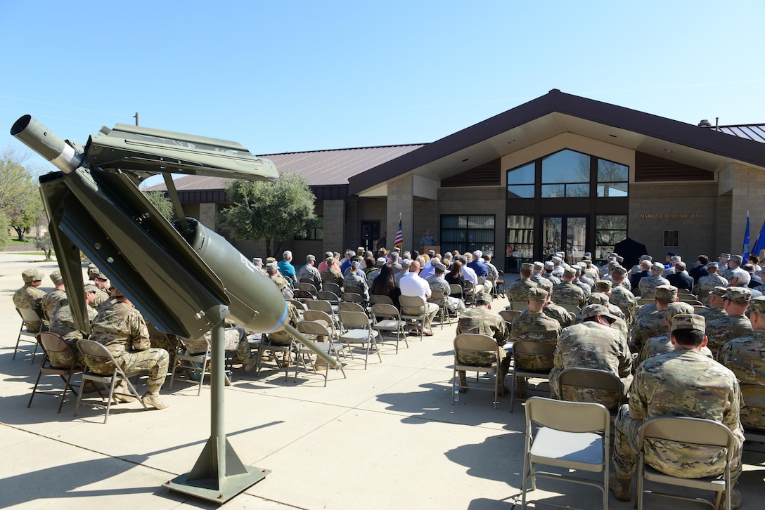 """The 9th Munitions Squadron hosts a ceremony March 18, 2016, at Beale Air Force Base, California, celebrating the 30th Anniversary of the Air Force Combat Ammunition Center (AFCOMAC). The event was attended by past and present AFCOMAC Airmen including the first """"AMMO Chief"""" Chief Master Sgt. retired Van D. Ray. (U.S. Air Force photo by Senior Airman Bobby Cummings)"""