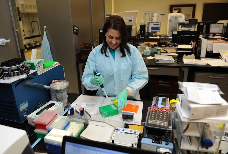 Samantha Pelligrino, 81st Medical Operations Squadron molecular technologist, prepares samples for a Next Generation Sequencing analysis at the 81st Medical Group's genetics center Mar. 16, 2016, Keesler Air Force Base, Miss. The Air Force Medical Genetics Center is the only laboratory of its kind in the entire Defense Department. Made up of the cytogenetics and molecular genetics labs, the center is focused on providing clinical and laboratory diagnostic services to support all DOD facilities worldwide. (U.S. Air Force photo by Kemberly Groue)