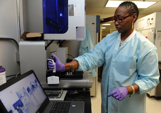 DeShannon Hall, 81st Medical Operations Squadron molecular technologist, uses a robotic sample prep handler at the 81st Medical Group's genetics center Mar. 16, 2016, Keesler Air Force Base, Miss. The Air Force Medical Genetics Center is the only laboratory of its kind in the entire Defense Department. Made up of the cytogenetics and molecular genetics labs, the center is focused on providing clinical and laboratory diagnostic services to support all DOD facilities worldwide. (U.S. Air Force photo by Kemberly Groue)