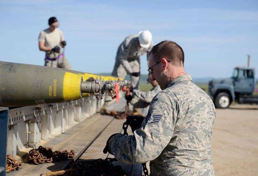 Airmen attending the Air Force Combat Ammunition Center (AFCOMAC) Combat Ammunition Planning and Production course, load ordnance onto a truck March 15, 2016, at Beale Air Force Base, California. AFCOMAC is celebrating its' 30th Anniversary this year. (U.S. Air Force photo by Senior Airman Bobby Cummings)