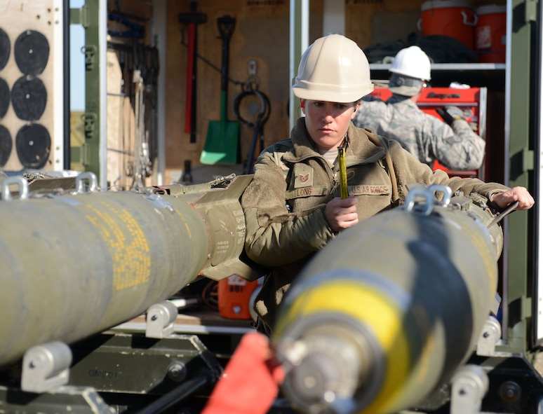 Tech. Sgt. Ashley Long, 9th Munitions Squadron combat advisor, inspects munitions March 15, 2016, at Beale Air Force Base, California. Combat advisors are experienced munitions technicians who advise munitions students attending the Air Force Combat Ammunition Center. (U.S. Air Force photo by Senior Airman Bobby Cummings)