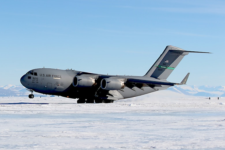 A C-17 Globemaster III aircraft out of Joint Base Lewis-McChord, Washington, lands on Pegasus Runway in Antarctica during the 2015 Operation Deep Freeze Season. Aircrews from the 446th and 62nd Airlift Wings from JBLM performed night-vision goggle landings during the Austral Winter. (Courtesy photo)