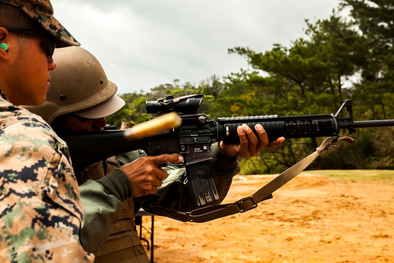 David Lucar fires an M16-A4 service rifle at Camp Schwab, Okinawa, Japan March 18, 2016. Lucar was able to experience dynamic facets of life in the Marine Corps. This included an Amphibious Assault Vehicle raid, firing the M9 service pistol, firing the M240B medium machine gun, wearing flak jackets with Kevlar helmets and eating packaged military rations. Lucar is an Okinawa resident and the uncle of a Marine with Combat Assault Battalion, 3rd Marine Division, III Marine Expeditionary Force. (U.S. Marine Corps photo by Pfc. Nelson B. Duenas /Released)