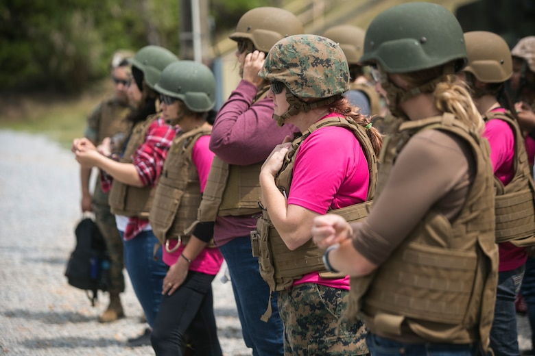 Marine spouses and family members receive safety briefs before conducting pistol and rifle ranges during a Jane Wayne event on Camp Schwab, Okinawa, Japan, March 18, 2016. These events bring families closer together, increase bonds and give loved ones a closer look at what their Marines do every day. The event was hosted by Combat Assault battalion, 3rd Marine Division, III Marine Expeditionary Force. (U.S. Marine Corps photo by Cpl. William Hester/ Released)