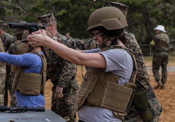Gina N. Hoss, wife of Chief Warrant Officer 3 Milton W. Hoss, fires the M9 service pistol during Jayne Wayne Day on Camp Schwab, March 18, 2016. During the day Gina learned to fire the M4-A1 carbine rifle and a M240B medium machine gun. Jayne Wayne Day is an event to help show Marine families what a day is like for a Marine. The event was hosted by Combat Assault Battalion, 3rd Marine Division, III Marine Expeditionary Force. (U.S. Marine Corps photo by Lance Cpl. Jessica N. Etheridge/Released)