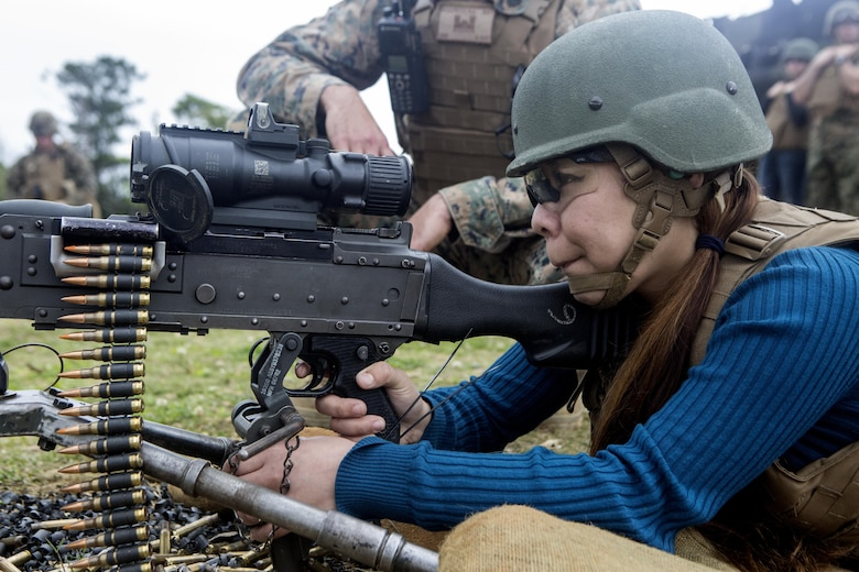 Ayumi Marsh, wife of SSgt. Anthony K. Marsh, fires the M240B medium machine gun during Jayne Wayne Day on Camp Schwab, March 18, 2016. Throughout the day Ayumi learned to fire the M9 service pistol and M4-A1 carbine rifle. Jayne Wayne Day is an event Marines families attend to experience a day in the life of their Marine. The event was hosted by Combat Assault Battalion, 3rd Marine Division, III Marine Expeditionary Force. (U.S. Marine Corps photo by Lance Cpl. Jessica N. Etheridge/Released)