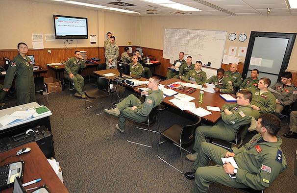 First Lt. Adria Trgovich, 350th Air Refueling Squadron navigator, briefs aircrews from the U.S. and Turkish air forces before their flights, March 8, 2016, at Nellis Air Force Base, Nev. The crews flew the first-ever joint KC-135 Stratotanker formation flights during Red Flag 16-2. (U.S. Air Force photo/Senior Airman David Bernal Del Agua)