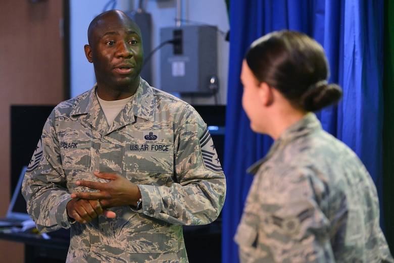 U.S. Air Force Chief Master Sgt. Vegas Clark, 39th Air Base Wing command chief, commends U.S. Air Force Airman 1st Class Katie Moeller, American Forces Network Incirlik broadcast producer, for her work in Titan University, March 11, 2016, at Incirlik Air Base, Turkey. Moeller has completed classes such as Little Brown Book…Little Blue Book, Customs and Courtesies, and Social Media and Email Protocol. (U.S. Air Force photo by Senior Airman John Nieves Camacho/Released)