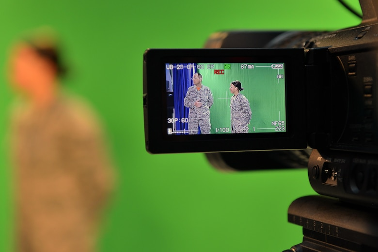 Viewed through a video camera, U.S. Air Force Senior Master Sgt. Kevin Pawlik, 39th Communications Squadron plans and programs flight superintendent, speaks about Titan University beside U.S. Air Force Airman 1st Class Katie Moeller, American Forces Network Incirlik broadcast producer, March 11, 2016, at Incirlik Air Base, Turkey. Titan University is Incirlik's professional development program and is geared toward promoting professional growth through the Air Force ranks. (U.S. Air Force photo by Senior Airman John Nieves Camacho/Released)