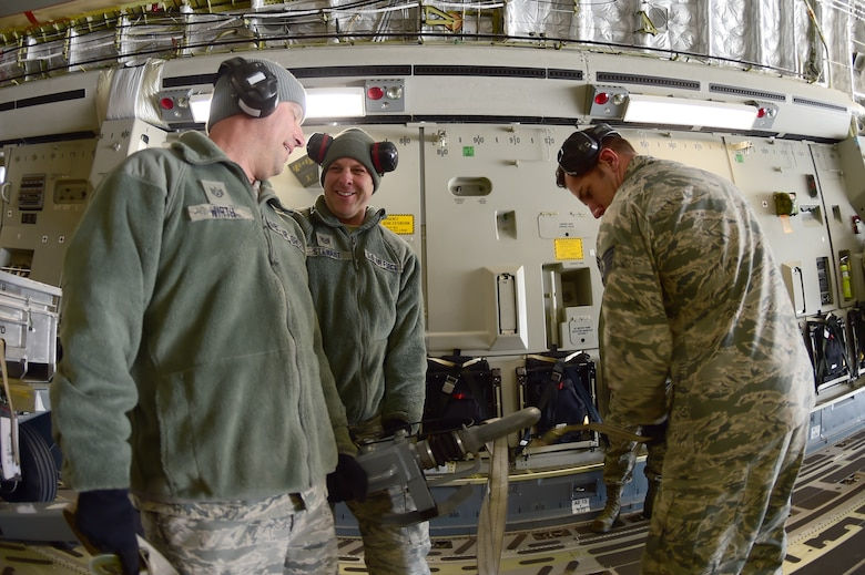 (left) Staff Sgt. Peter Wirth, 140th Maintenance Squadron equipment maintenance technician, Tech. Sgt. Alex Stewart, 140th MXS aerospace ground equipment mechanic and Tech Sgt. Garrett Fintel, 140th MXS munitions technician, assist in loading a C-17 Globemaster III March 15, 2016, on Buckley Air Force Base, Colo. The aircraft, assigned to the 172nd Airlift Wing, Jackson, Mississippi, supported the 140th Wing transport equipment to Tyndall AFB, Florida, for an exercise. (U.S. Air Force photo by Airman 1st Class Luke W. Nowakowski/Released)