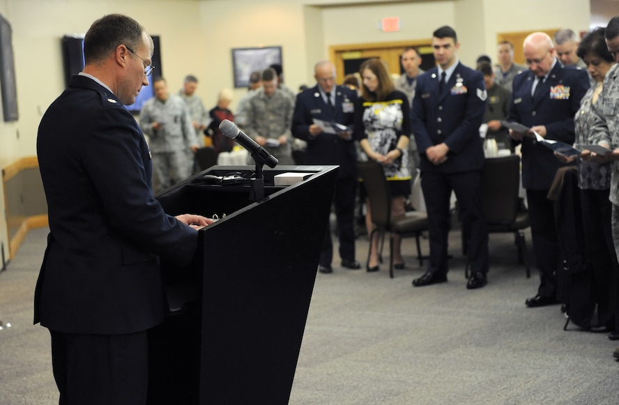 U.S. Air Force Lt. Col. Lance McInnish, the 509th Bomb Wing director of staff, leads members of Team Whiteman in prayer during the National Prayer Breakfast at Whiteman Air Force Base, Mo., March 11, 2016. The prayer was derived from the 2nd inaugural speech by President Abraham Lincoln. (U.S. Air Force photo by Airman 1st Class Michaela R. Slanchik)