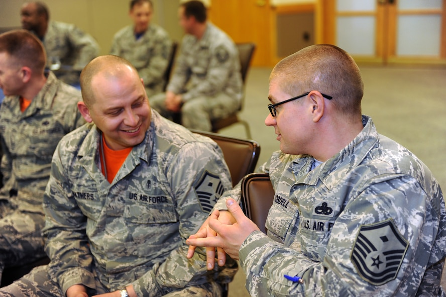 U.S. Air Force Master Sgt. Michael Mathers, left, and Master Sgt. Corey Lobdell, both Whiteman first sergeants, practice a listening and communication skills exercise during Profession of Arms Center of Excellence (PACE) training at Whiteman Air Force Base, Mo., March 4, 2016. PACE was designed to teach leaders how to embody a higher level of professionalism and communication to lead more effectively. (U.S. Air Force photo by Airman 1st Class Michaela R. Slanchik)