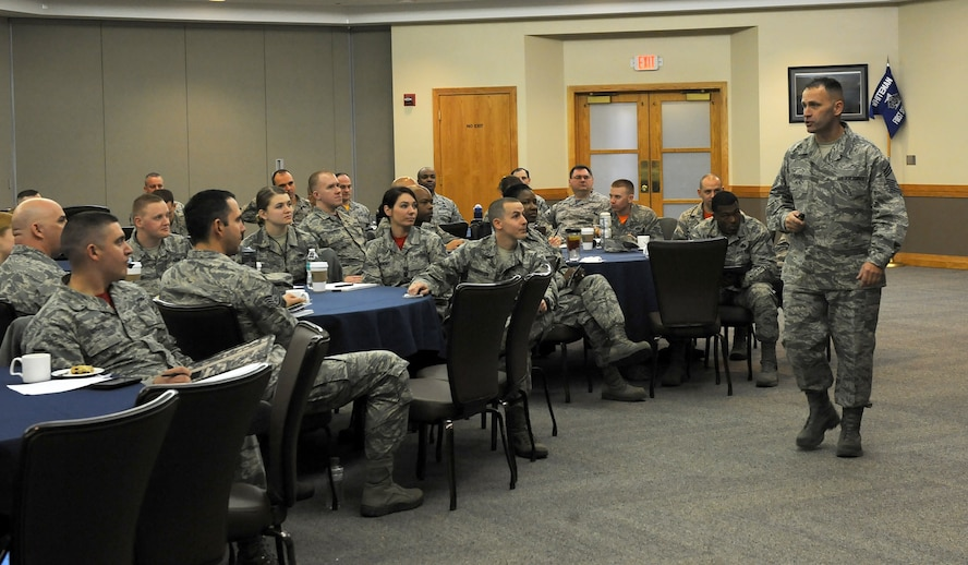 U.S. Air Force Chief Master Sgt. Anthony Fisher, the superintendent of Profession of Arms Center of Excellence (PACE), briefs senior enlisted leaders during PACE training at Whiteman Air Force Base, Mo., March 4, 2016. The training included tips on bridging the Air Force core values and its mission to accomplish a higher level of professionalism through trust, loyalty and commitment. (U.S. Air Force photo by Airman 1st Class Michaela R. Slanchik)