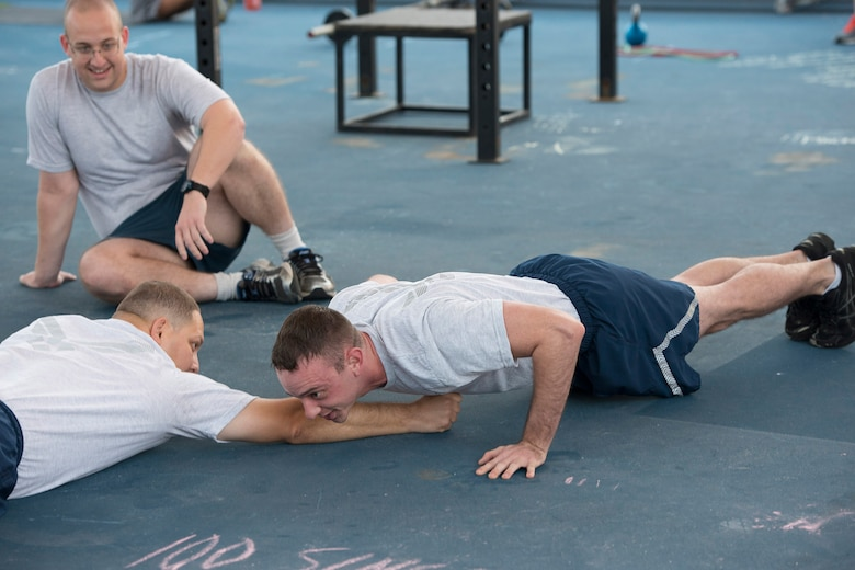 An Airman performs push-ups during the 1946 Army Physical Fitness Test Challenge March 18, 2016, at the Patrick Air Force Base fitness center, Fla. The challenge served as a tribute to the first women who entered the military, which were required to complete the physical fitness test in order to join. (U.S. Air Force photo by Matthew Jurgens/released)