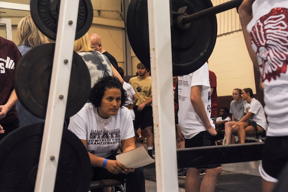 Capt. Andrea Gallegos, Holm Center curriculum area manager, judges the form of an athlete during the Alabama State Powerlifting Championships March 12, 2016, at Eclectic, Alabama. There were 31 Maxwell Airman who volunteered to help the local high school put on their annual event. (U.S. Air Force photo by Airman 1st Class Alexa Culbert)