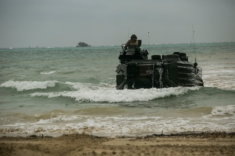 """Marines and their loved ones experienced an Amphibious Assault Vehicle """"splash"""" during a Jane Wayne event on Camp Schwab, Okinawa, Japan, March 18, 2016. These events provide a good bonding opportunity while giving Marine's family members a closer look at their day-to-day lives. The AAVs are with Combat Assault Battalion, 3rd Marine Division, III Marine Expeditionary Force. (U.S. Marine Corps photo by Cpl. William Hester/ Released)"""