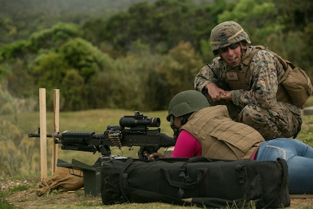 Latoya M. Williams fires an M240B medium machine gun during a Jane Wayne event on Camp Schwab, Okinawa, Japan March 18, 2016. Jane Wayne is an event that allows Marines from Combat Assault Battalion to bring their spouses or family members to interact in military based events. The events give them a better idea of what their service member does every day. At this event spouses and family members were able to shoot rifles, pistols, machine guns and ride in amphibious assault vehicles. Williams is from Crystal Springs, Mississippi, and married to 1st Sgt. Ceasare Williams, CAB, 3rd Marine Division, III Marine Expeditionary Force. (U.S. Marine Corps photo by Cpl. William Hester/released)