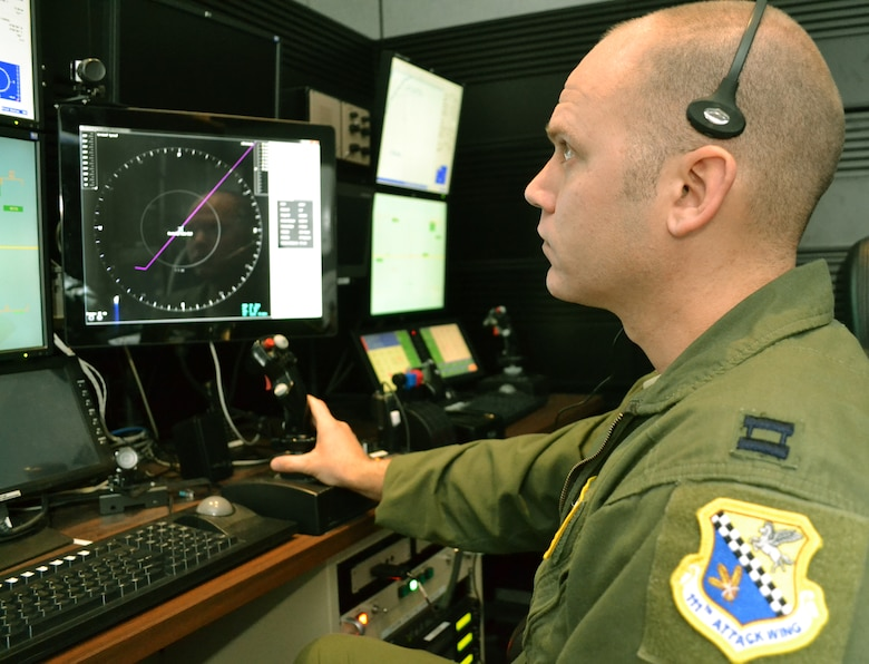 Capt. Christopher, a 103rd Attack Squadron pilot at Horsham Air Guard Station, Pa.,  operates an MQ-9 Reaper flight simulator at the FAA William J. Hughes Technical Center, Atlantic City, N.J., March 3, 2016. The Federal Aviation Administration selected eight 111th Attack Wing pilot volunteers from Horsham AGS for a study aimed at developing a Detect and Avoid display for unmanned aircraft systems. (U.S. Air National Guard photo by Tech. Sgt. Andria Allmond)