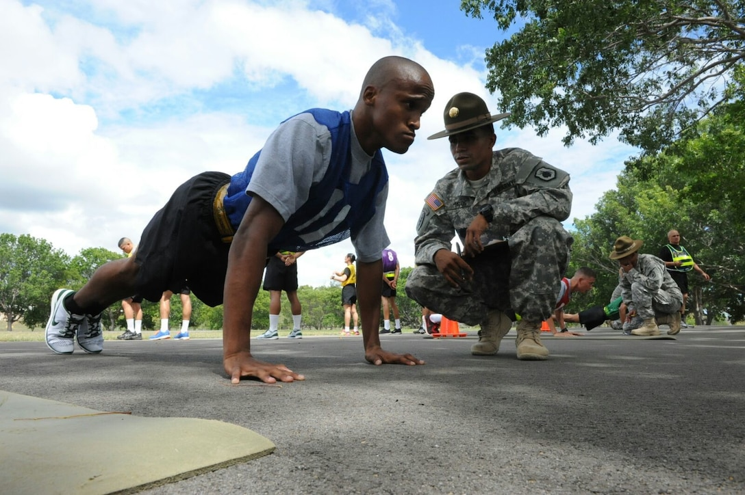Private 1st Class Andrew I. Rosser, 210th Regional Support Group, performs pushups during the Army Physical Fitness Test portion of the Best Warrior Competition at Camp Santiago, Puerto Rico, March 14.